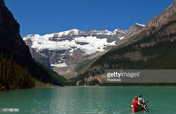 Couple In Canoe Lake Louise Banff