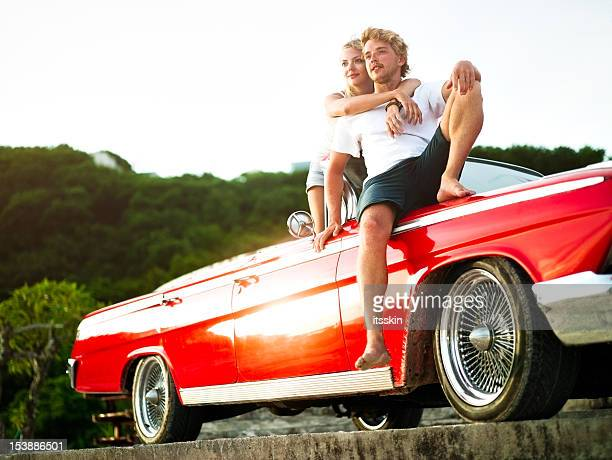 Couple in car watching sunset