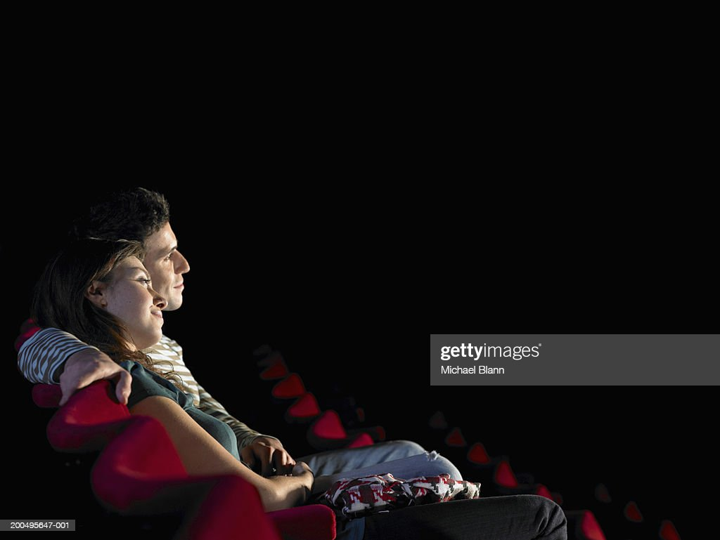 Couple in cinema, side view