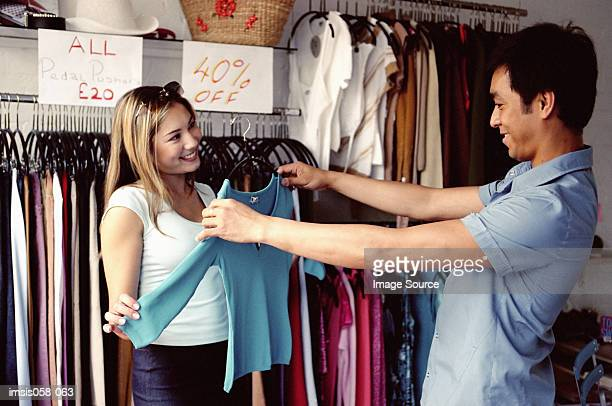 Couple in clothes shop