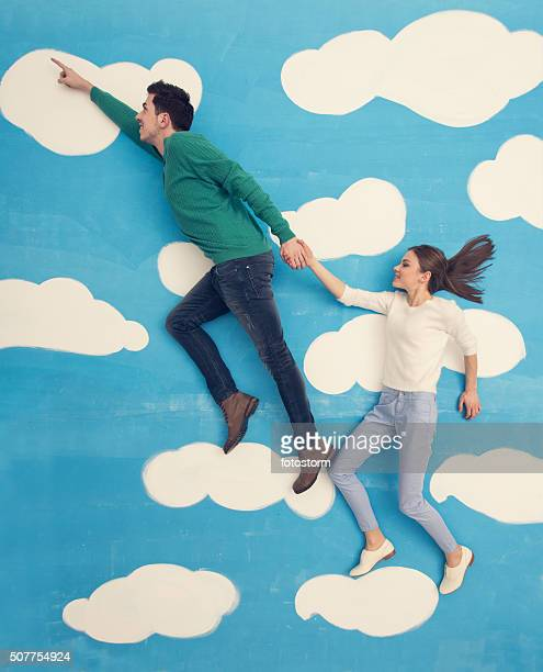 Couple in comic book: running in the clouds
