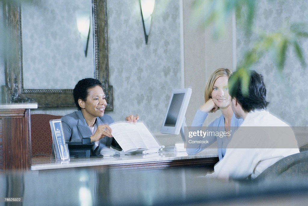 Couple in consultation with businesswoman