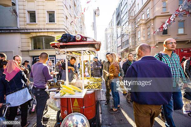 Couple in crowd buying snacks on Istiklal Street, Istanbul