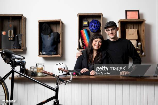 Couple in cycling accessories shop