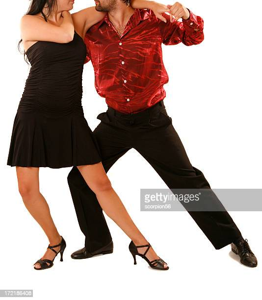 Couple in dancing attire performing a tango movement