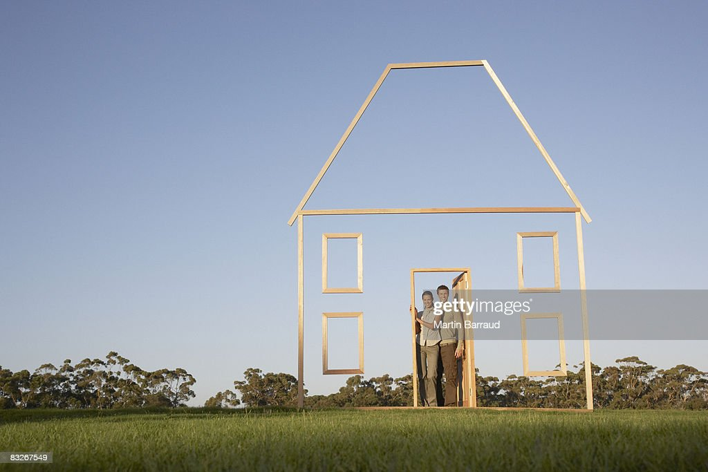 Couple in doorway of house outline : Stock Photo