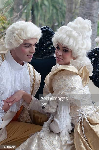 Couple in fancy dress flirting