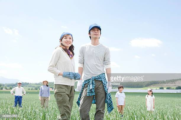 Couple in field, family in the background