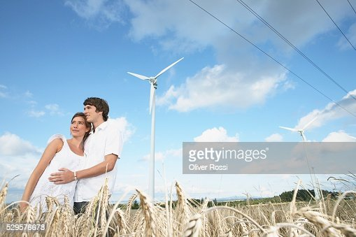Couple in Field with Windmills : Stock Photo
