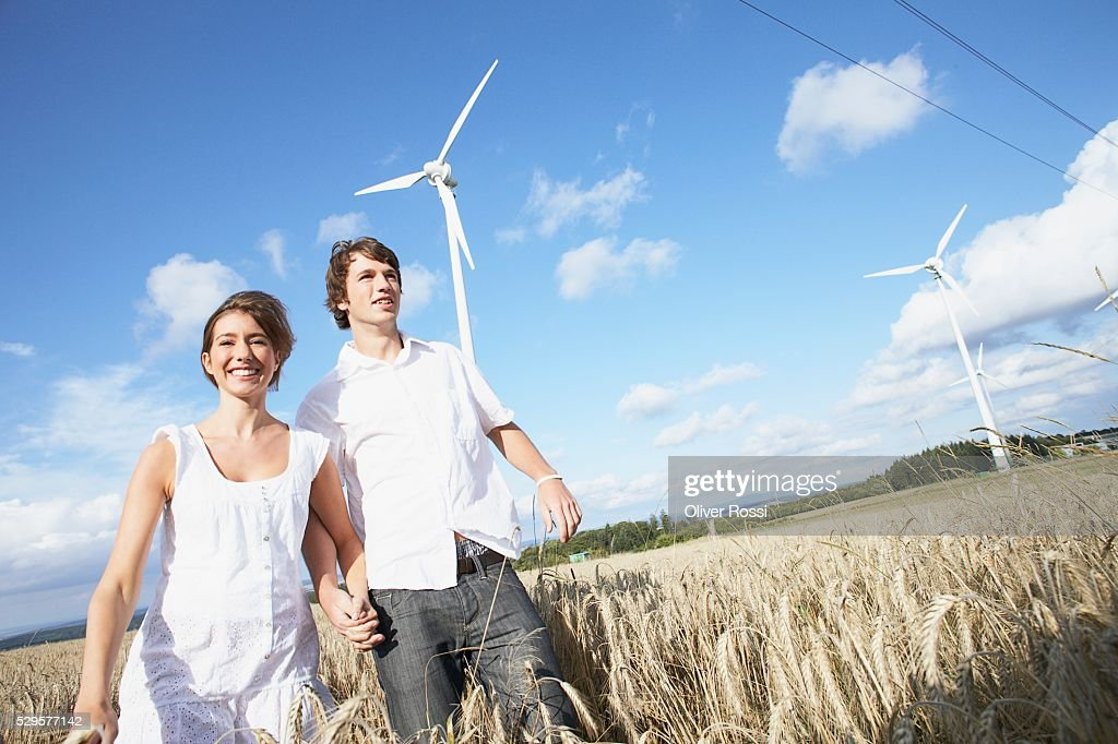 Couple in Field with Windmills : Bildbanksbilder