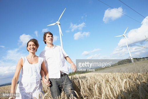 Couple in Field with Windmills : Stock-Foto