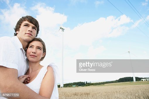 Couple in Field with Windmills : Foto de stock