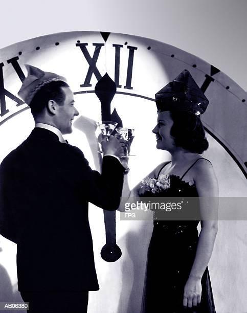 Couple in formal wear celebrating New Year (B&W)