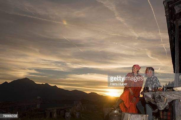 Couple in front of mountain hut