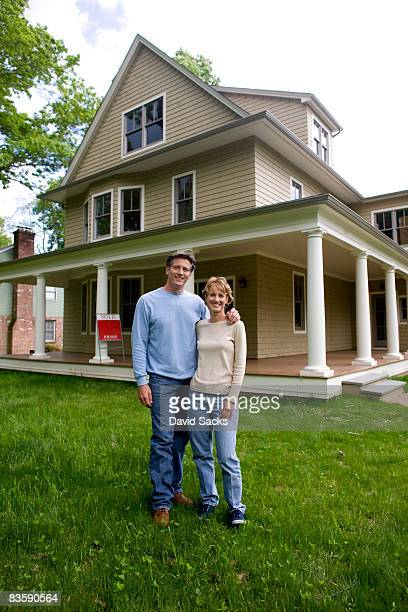 Couple in front of new house