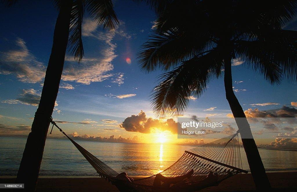 Couple in hammock at sunset, Westin Denarau Island resort and spa, near Nadi. : Stock Photo