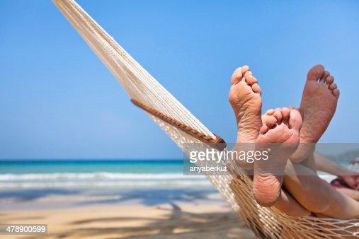 couple in hammock on the beach : Stock Photo