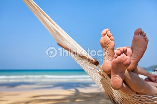 couple in hammock on the beach : Stock Photo