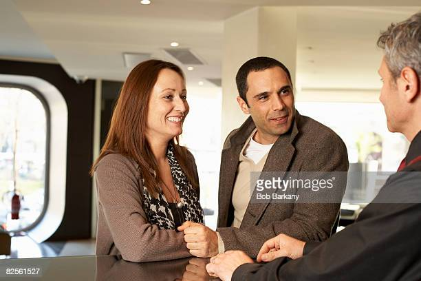 Couple in hotel talking to concierge
