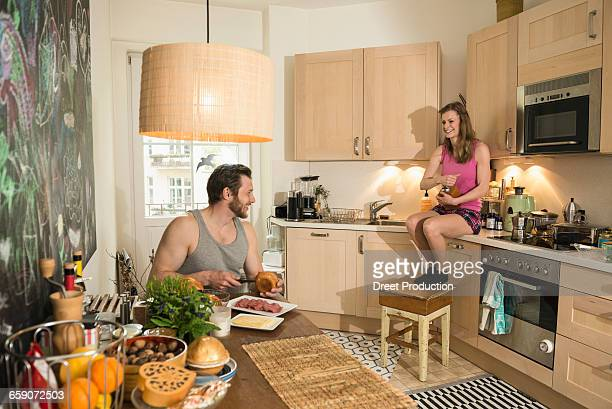 Couple in kitchen preparing breakfast, Munich, Bavaria, Germany