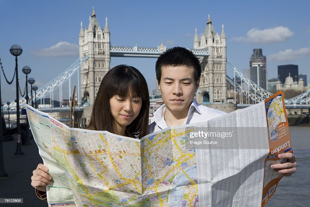 Couple in London with map : Stock Photo