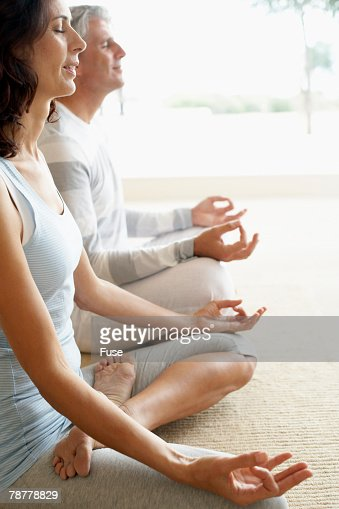 Couple in Lotus Posture at Home