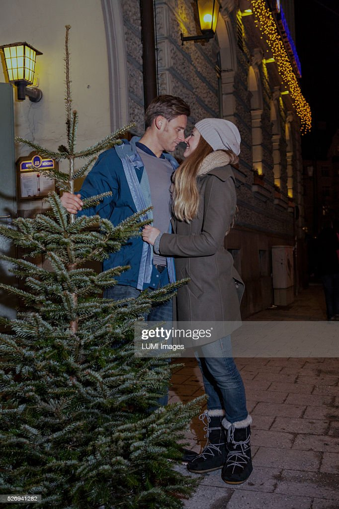 Couple, in love, carrying their Christmas tree home, Bavaria, Germany : Photo