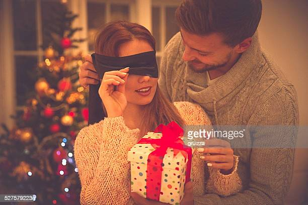 Couple in love celebrating Christmas giving a gift