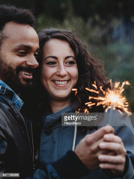 Couple in love holding a sparkler firework