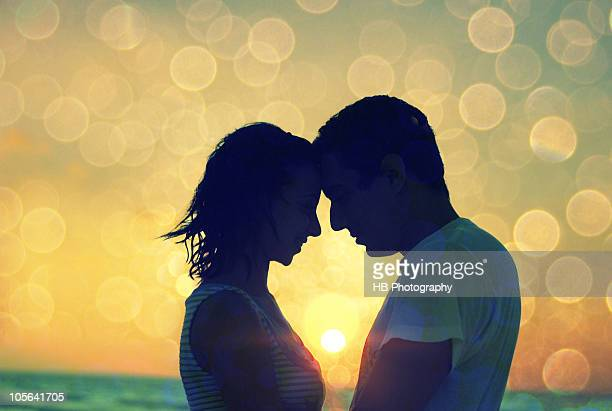 A couple in love in the sunset on the beach