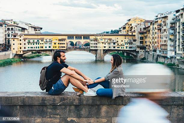 Couple in love near Ponte Vecchio bridge in Florence