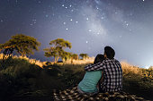 couple in love under stars of Milky Way Galaxy Odessa