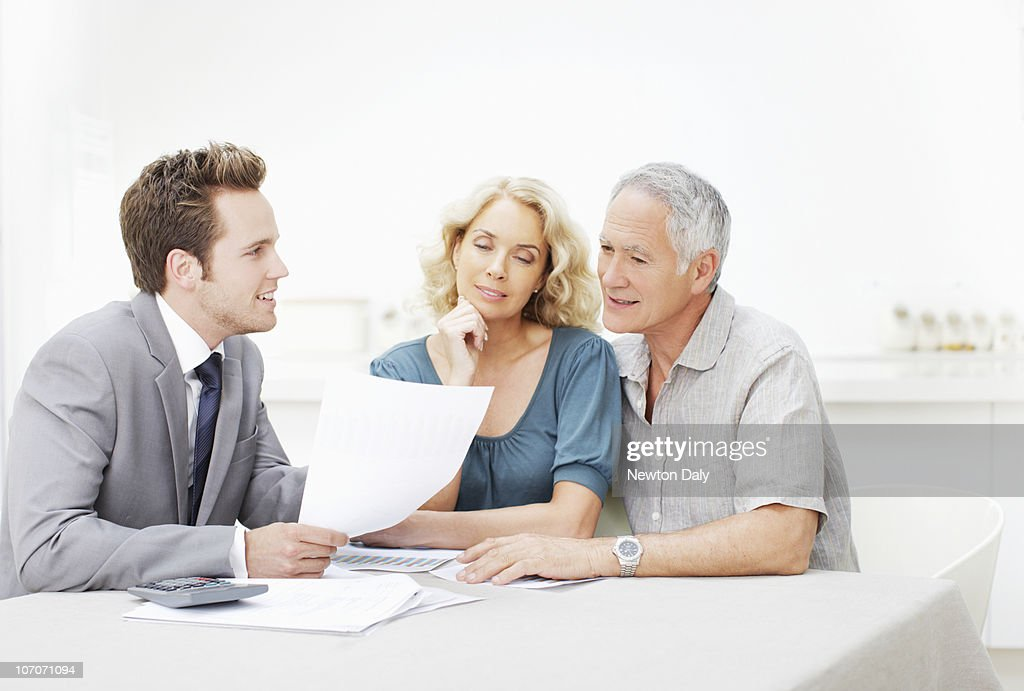 Couple in meeting with financial adviser : Stock Photo