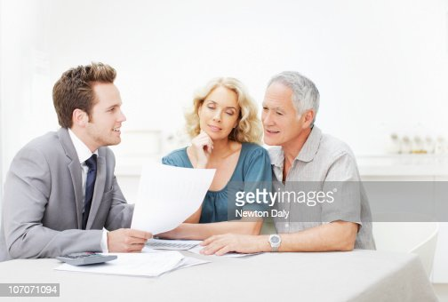 Couple in meeting with financial adviser : Photo