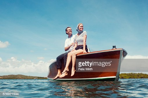 Couple in motorboat on lake : Stock Photo