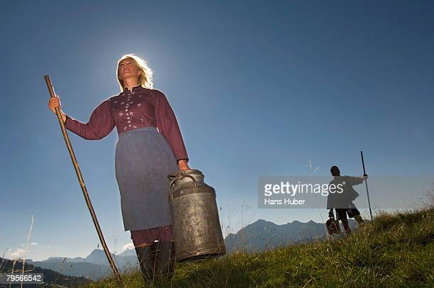 Couple in mountains holding crook