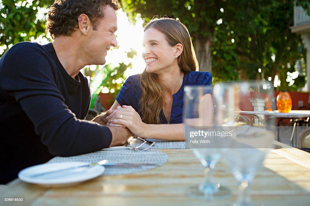 Couple in outdoor restaurant : Stock Photo