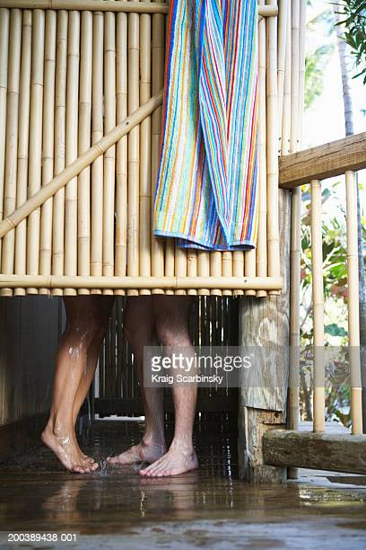 Couple in outdoor shower