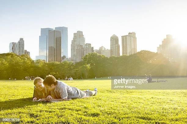 Couple in park, skyline on background