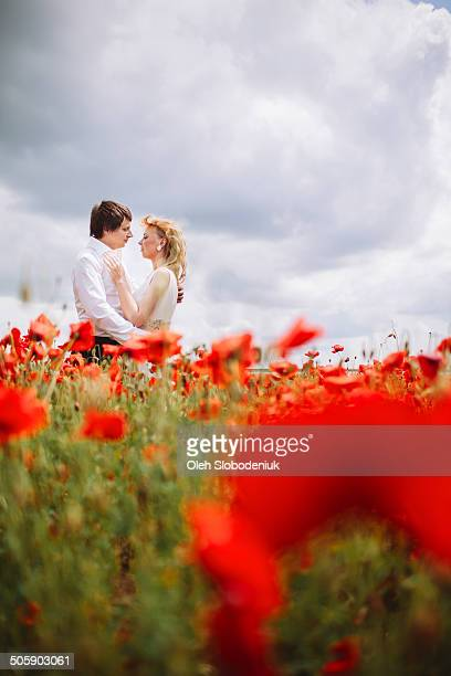 Couple in poppies