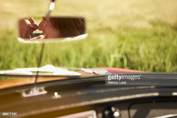 Couple in rear view mirror, will kiss