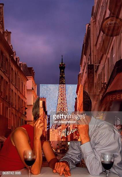Couple in restaurant, in front of Eiffel Tower, Paris, France (DC)