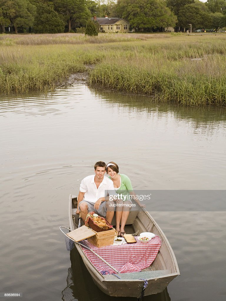 Couple in rowboat : Stock Photo