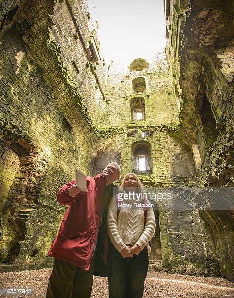 Couple in ruined walls of Bolton Castle, a 14th century Grade I listed building and a Scheduled Ancient Monument.