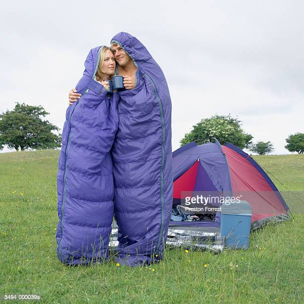 Couple in Sleeping Bags Hug