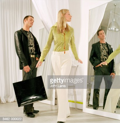 Couple in Store Fitting Room : Stock Photo