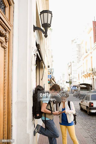 Couple in street looking at map