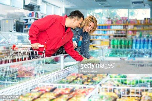 Couple in supermarket near frozen food