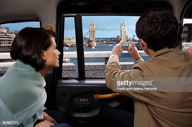Couple in taxi, view of Tower Bridge