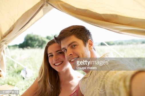 Couple in tent taking photo of themselves. : Stock Photo